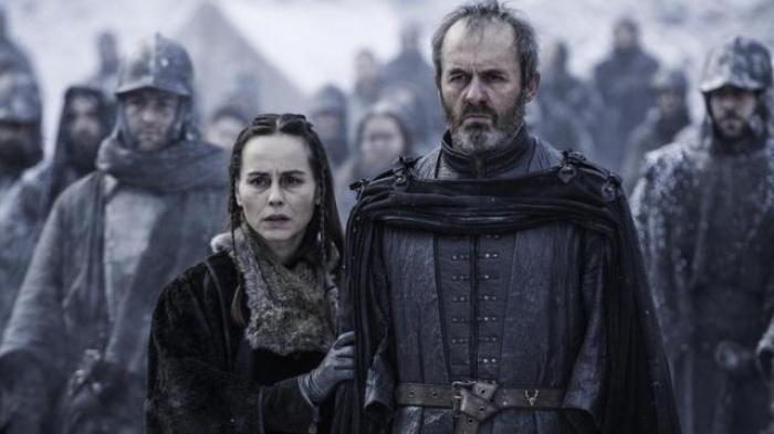 Stannis and his wife during the execution of their young daughter Shireen