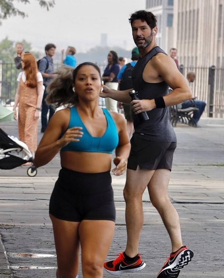 Tom Ellis and Gina Rodriguez on the set of players